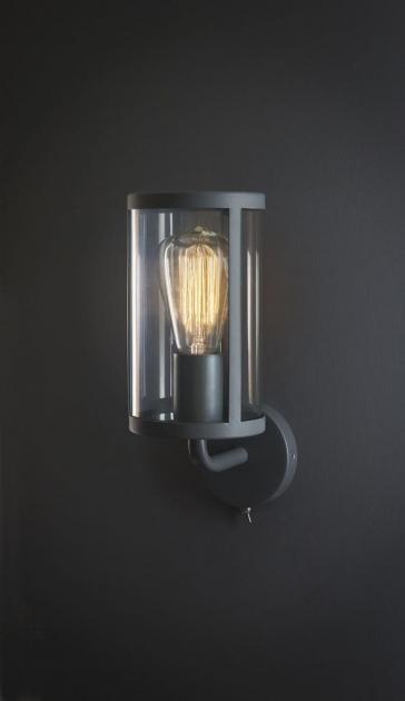 Grey cadogan wall light on a black wall