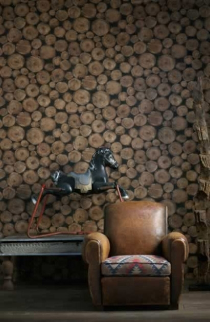 lifestyle image of Andrew Martin Engineer Collection - Lumberjack Log Wallpaper - 2 Colours Available with brown leather armchair and black rocking horse decoration