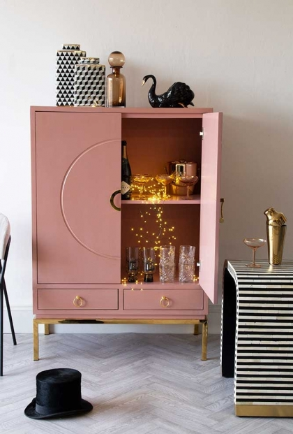 Lifestyle party image of the Fabulous Pink Drinks Cabinet with one door open