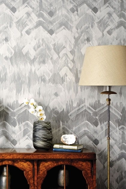 lifestyle image of 17 Patterns Brushed Herringbone Wallpaper - 4 Colours Available with wooden cabinet with vase on and cream floor lamp