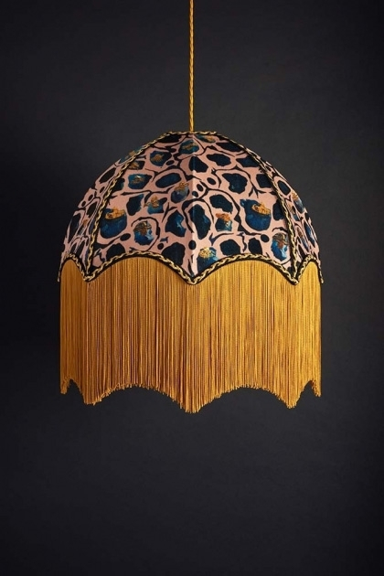 lifestyle image of Anna Hayman Designs DecoFabulous Blush Giraffe Pendant Shade on dark wall background