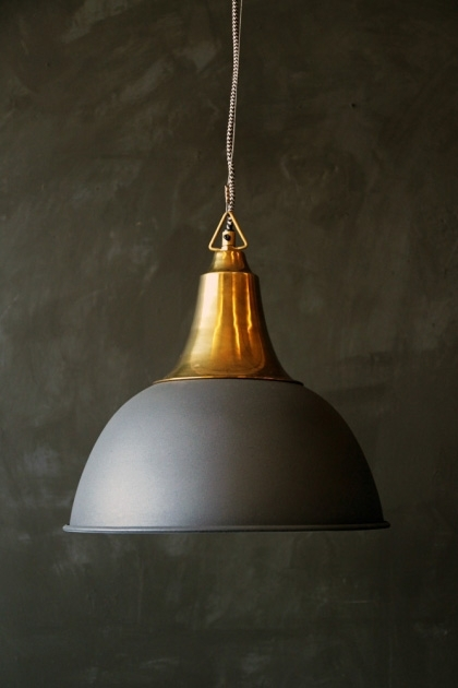 lifestyle image of Antique Brass Ceiling Light With Matt Grey Shade on dark wall background