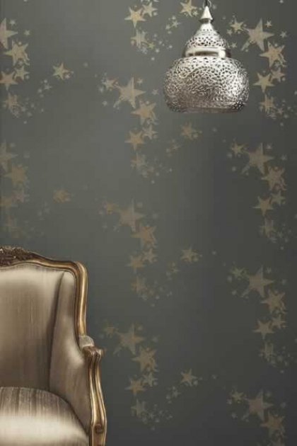 lifestyle image of Barneby Gates All Star Wallpaper - Gun Metal with gold armchair and silver ceiling light