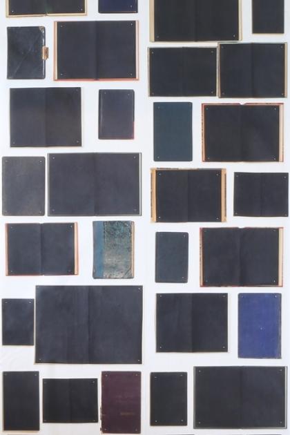 cutout Image of NLXL EKA06 Biblioteca Wallpaper by Ekaterina Panikanova - Black Books open and closed dark coloured books in a flat lay image