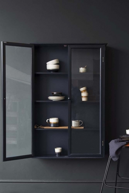lifestyle image of Black Pine Display Cabinet wit door open and filled with tableware on dark wall background