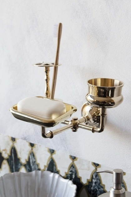 Lifestyle image of the Brass Trio 3-in-1 Bathroom Accessory on white wall background and patterned wallpaper