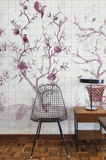 Lifestyle image of the Chinoiserie Tile Wallpaper Mural - Meihua Goji with black chair and side table with modern table lmap on top with wooden flooring