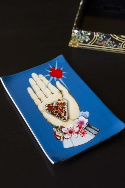lifestyle image of Christian Lacroix Maison De Jeu Trinket Tray with box in background on black table