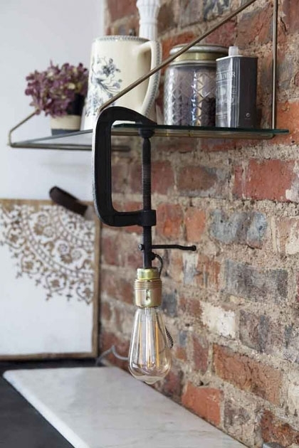 Lifestyle of Clamp Table Lamp on kitchen shelf with brick wall and marble counter