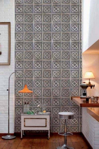 lifestyle image of Clover Wallpaper with white side table with orange table lamp on and white bar stool at kitchen worktop