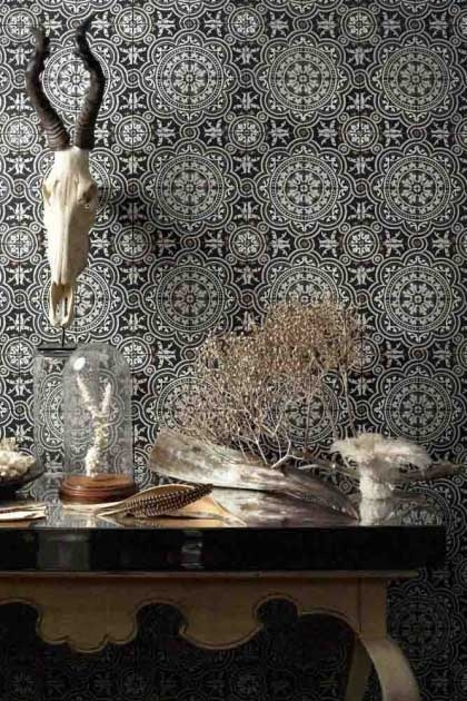 lifestyle image of Cole & Son The Albemarle Collection - Piccadilly Wallpaper - 4 Colours Available with wooden table and skull with horns on wall