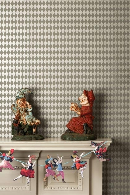 lifestyle image of Cole & Son Whimsical Collection - Titania Wallpaper - 5 Colours Available with white table and punch and Judy statues and bunting