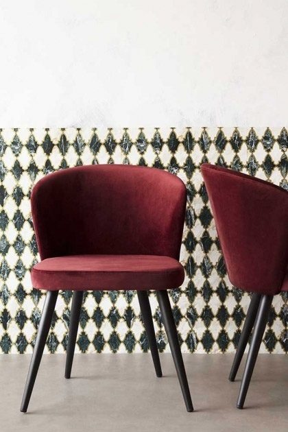 Front on lifestyle image of the Merlot Red Deco Velvet Dining Chair with patterned wallpaper background and pale flooring