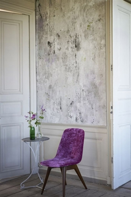 lifestyle image of Designers Guild Jardin Des Plantes Collection - Corneille Wallpaper - 3 Colours Available with purple dining chair and side table