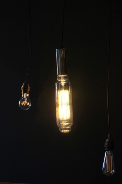 lifestyle image of E40 11W Extra Large LED Tower Bulb lit up in dark room