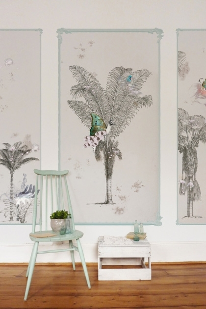 lifestyle image of Elli Popp Baudelaire's Dream Wallpaper with green chair with plant and small white side table