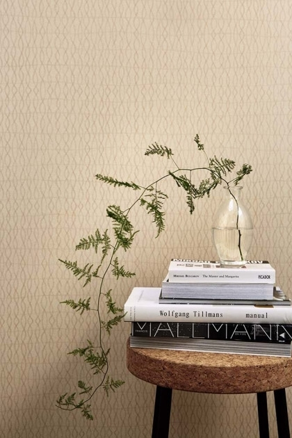 lifestyle image of Engblad & Co Atmospheres Collection - Medium Knit Wallpaper - 3 Colours Available with wooden side table with pile of books and plant on top