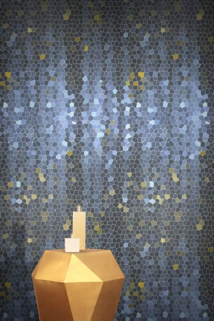 lifestyle image of Feathr Firefly Wallpaper - Blue with gold side table and candles on top