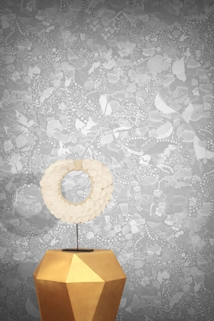 lifestyle image of Feathr La Cueillette Wallpaper - Grise with gold side table and round table lamp on top