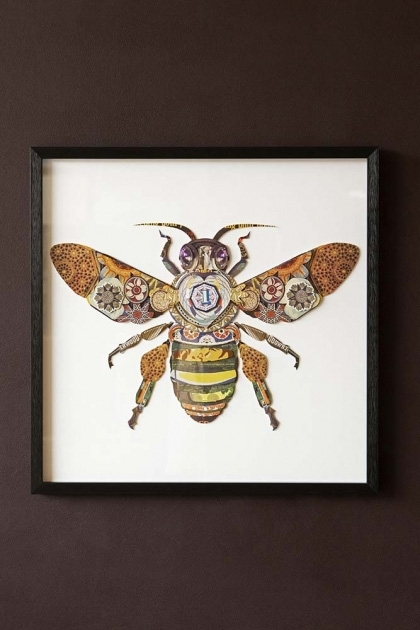 Lifestyle image of the Framed Bee Collage Art Print hanging on the wall wit white background on dark brown wall background