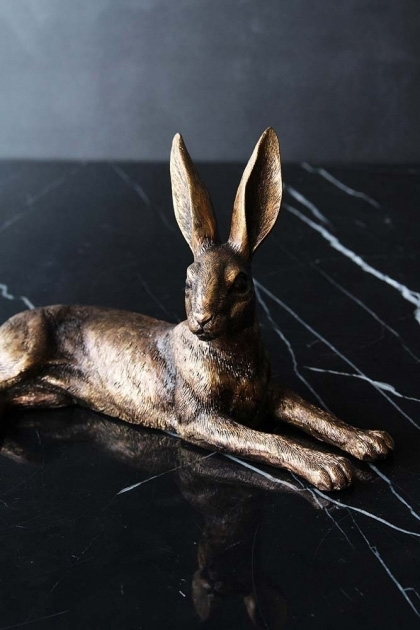 lifestyle image of Golden Hare Ornament laying down on black table