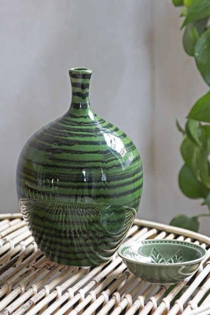Lifestyle image of the Glazed Green Bottleneck Vase