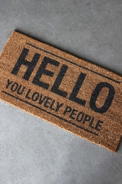 'Hello You Lovely People' Doormat on concrete floor lifestyle image
