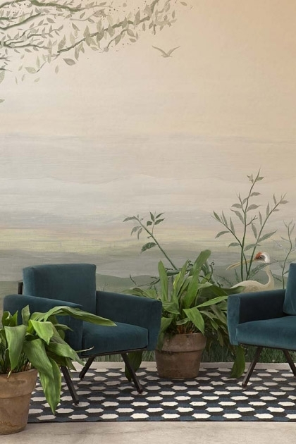 Lifestyle image of the Landscape Wallpaper Mural - Yugure Aloe with two blue velvet armchairs and house plants on black and white checkered floor