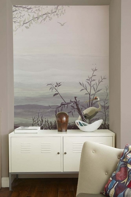 Lifestyle image of the Landscape Wallpaper Mural - Yugure Rose Pink with white double cabinet with table lamp on top and green arm chair in foreground