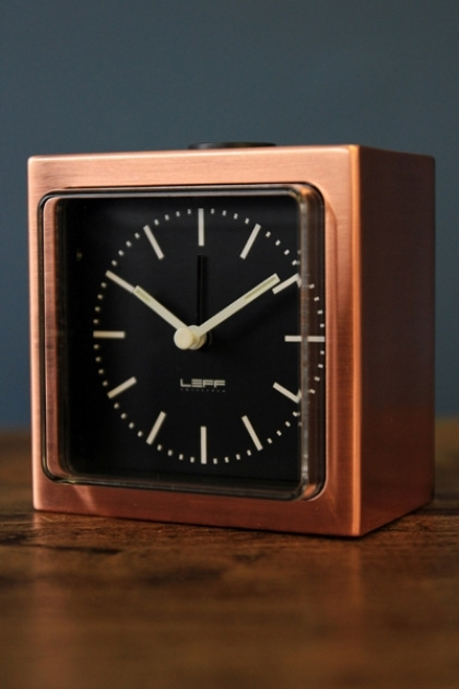 LEFF Amsterdam Block Alarm Clock - Copper on blue background lifestyle image