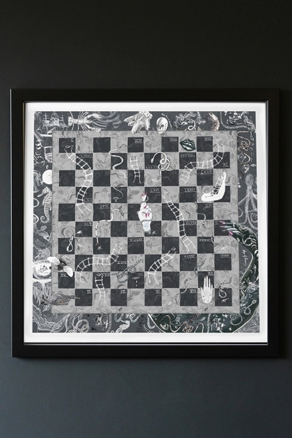 lifestyle image of Limited Edition Snakes & Ladders Art Print in black frame hung on dark grey wall background