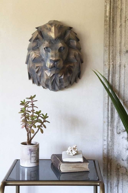 Front on lifestyle image of the Gold Art Deco Lion Head Wall Decoration