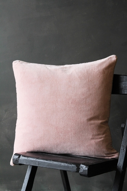 Lifestyle image of Luxury Velvet Cushion - Blush Pink on black wooden chair with dark grey wall background