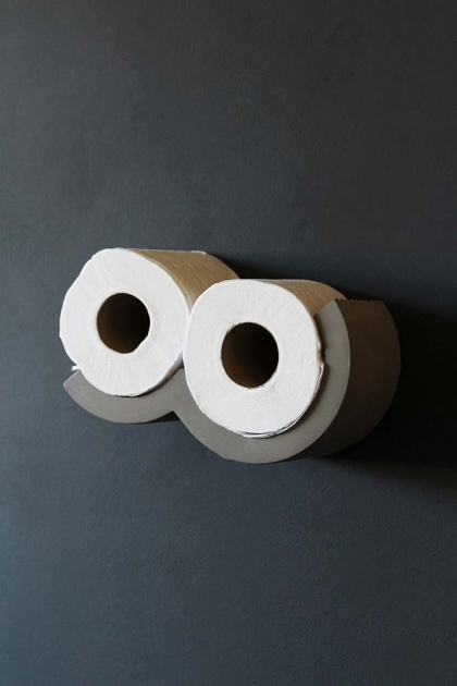 lifestyle image of Lyon Beton Concrete Cloud Toilet Roll Shelf - XS with toilet roll in on dark grey wall background