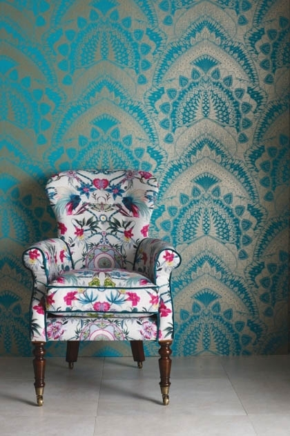 lifestyle image of Matthew Williamson Azari Wallpaper - 6 Colours Available patterned armchair on grey flooring