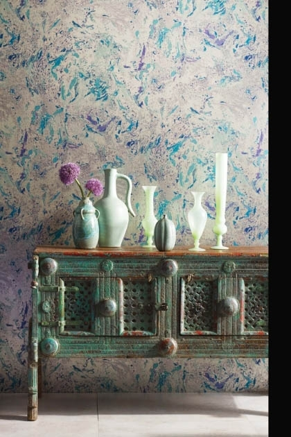 lifestyle image of Matthew Williamson Makrana Wallpaper - 5 Colours Available with green distressed wooden desk and green vases on top
