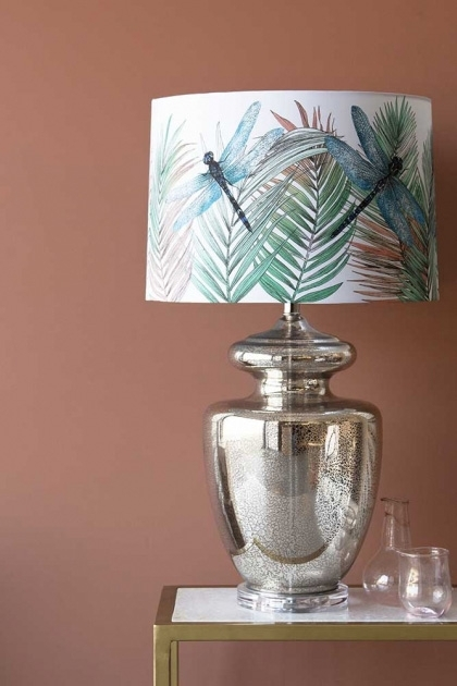Close-up lifestyle image of the Matthew Williamson Palm Springs Table Lamp & Dragonfly Shade on glass and marble side table with neutral coloured wall background