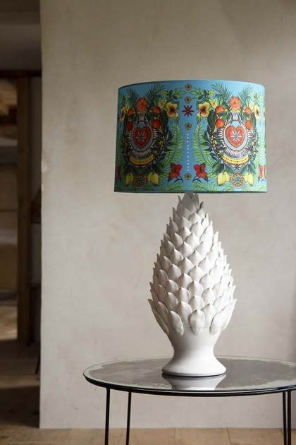 Lifestyle image of the Matthew Williamson Spanish Summer Siesta Table Lamp & Shade on dark side table with pale wall background