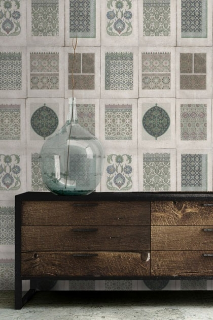 lifestyle image of Mind The Gap Arabesque Wallpaper with wooden cabinet and blue vase ornament