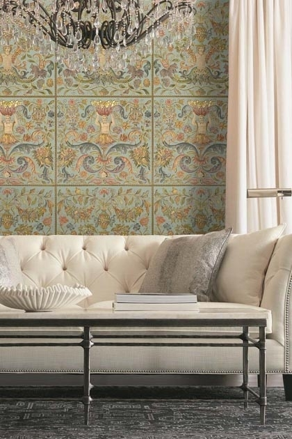 Lifestyle image of the powder Brocade wallpaper with large pale colored sofa and black metal coffee table with chandelier hanging from ceiling