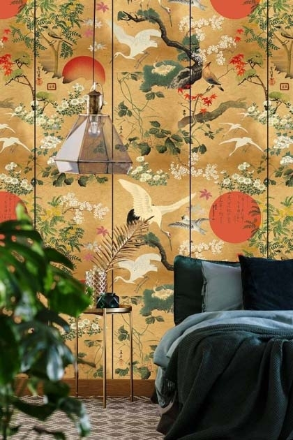 Lifestyle image of the standard version of the ByoBu wallpaper in a bedroom setting with black bedding on bed and large house plant on patterned flooring