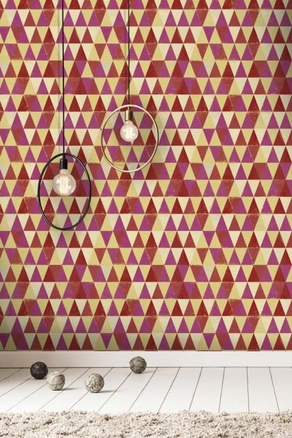 lifestyle image of Mind The Gap Circus Pattern Wallpaper with two ceiling lights and balls on white wooden floor