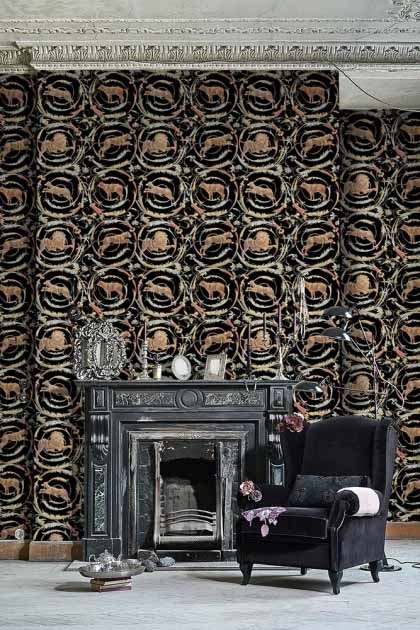 lifestyle image of Mind The Gap The World Of Antiquity - Fresce Wallpaper - Anthracite with grey fireplace and black armchair