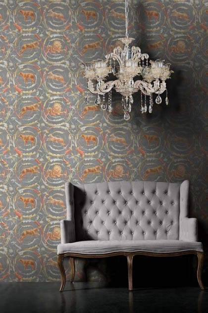 lifestyle image of Mind The Gap The World Of Antiquity - Fresce Wallpaper with grey sofa and white chandelier