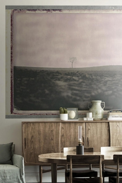 lifestyle image of Mr Perswall Wallpaper - Eco Dimensions - Alone III 8134 behind wooden cabinet and dining table with chairs