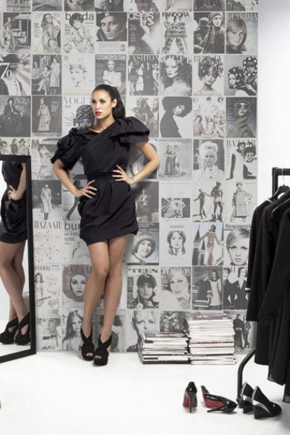 lifestyle image of Mr Perswall Wallpaper - Fashion Collection - Fashion Covers P140601-4 with model in black dress next to mirror and black clothing line
