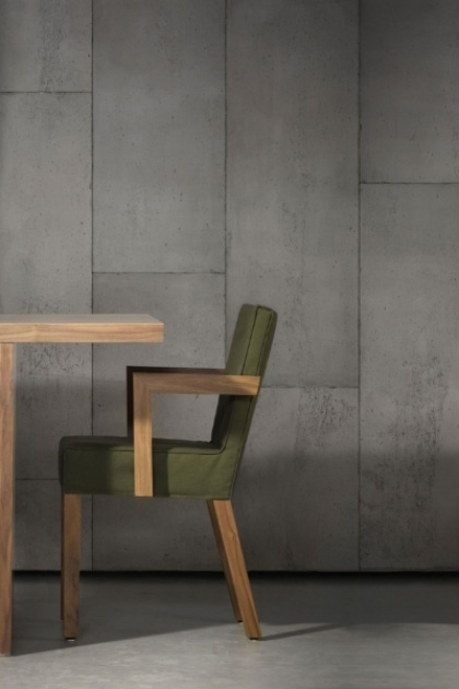 lifestyle image of NLXL CON-01 Concrete Wallpaper by Piet Boon with green chair and wooden table on grey flooring