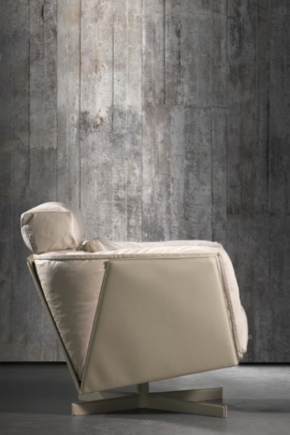 lifestyle image of NLXL CON-02 Concrete Wallpaper by Piet Boon with side view of white armchair
