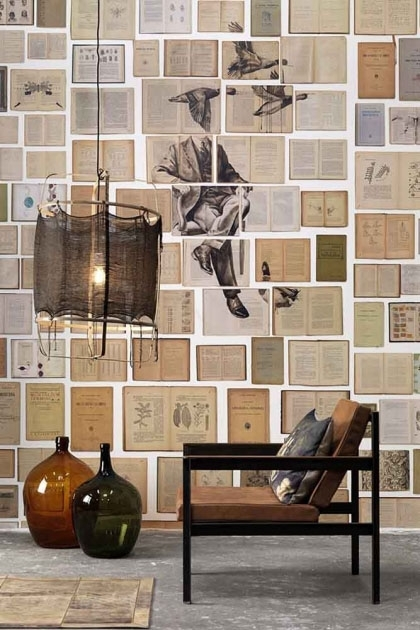 Lifestyle image of the NLXL EKA01 Biblioteca Wallpaper by Ekaterina Panikanova - Mural 1: Ducks man and ducks flying on pale coloured books