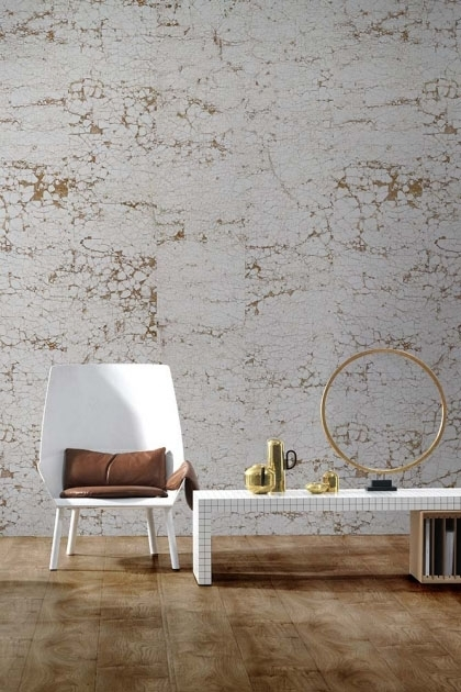 lifestyle image of NLXL NCA-01 Crack Wallpaper by Nacho Carbonell with white chair and brown blanket and white coffee table with round gold ornament on